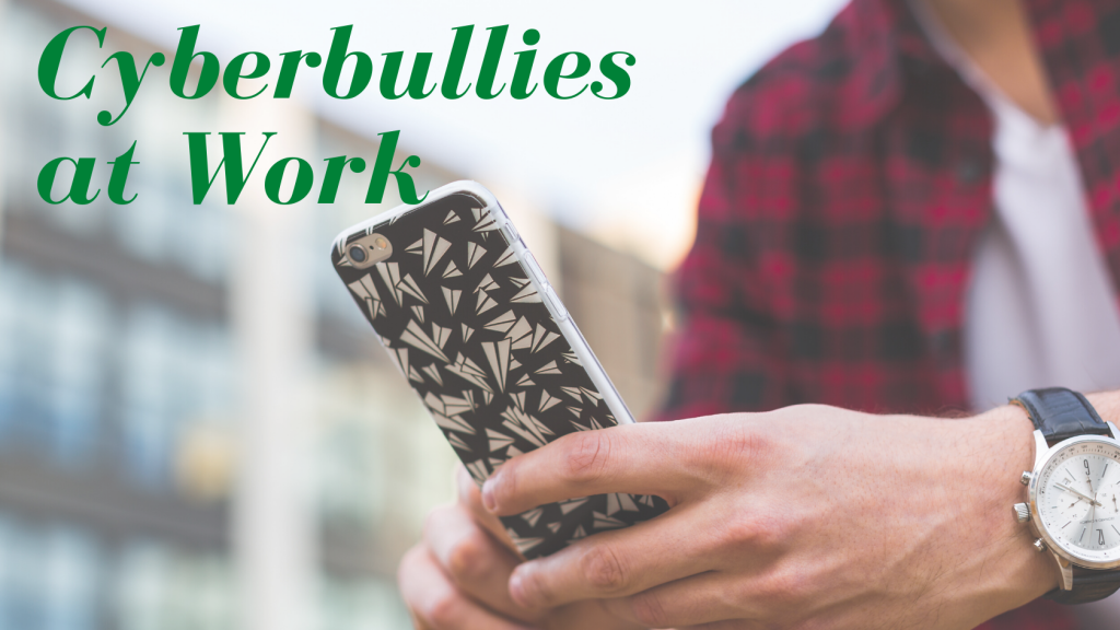 man's hands with phone; cyberbullies at work; momentum consulting